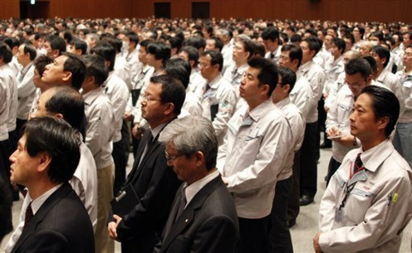 Employees of Toyota Motor Co., listen to Akio Toyoda, President of Toyota Motor, Co, during a Toyota's crisis meeting in Toyota city, central Japan, Friday, March 5, 2010. Toyota's brand is in crisis but its cars are safe, top executives told thousands of workers at a meeting Friday aimed at boosting morale amid the automaker's recall crisis. (AP Photo/Koji Sasahara)