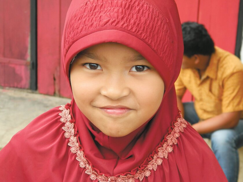 In the Muslim section of the remote island of Sulawesi, a schoolgirl spoke in perfect English with a group of strangers before agreeing to some pictures.