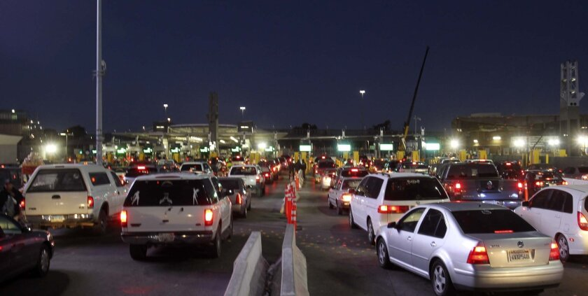 Wait times at the San Ysidro Port of Entry could rise from three hours at peak weekend times to five hours if sequestration cuts go through, the White House says. [U-T file]
