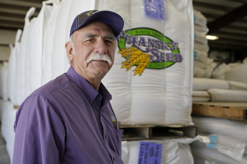 Adrian Polansky, a farmer and former executive director of the USDA's Farm Service Agency office in Kansas during the Obama administration, stops for a photo while touring his seed processing plant near Belleville, Kan., Friday, March 5, 2021. More than a year after two U.S. Department of Agriculture research agencies were moved from the nation's capital to Kansas City, they remain critically understaffed and some farmers are less confident in the work they produce. (AP Photo/Orlin Wagner)