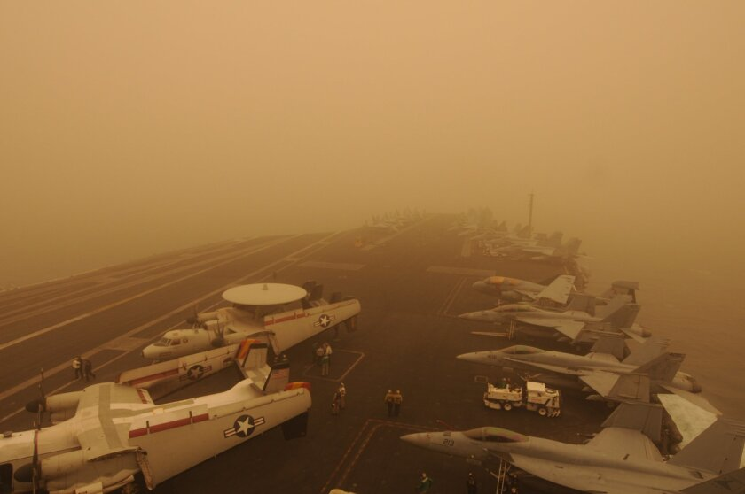 "The Navy says, ""The Nimitz-class aircraft carrier USS Carl Vinson (CVN 70) (on Monday) passes through a sand storm. Carl Vinson and Carrier Air Wing (CVW) 17 are deployed to the U.S. 5th Fleet area of responsibility."""