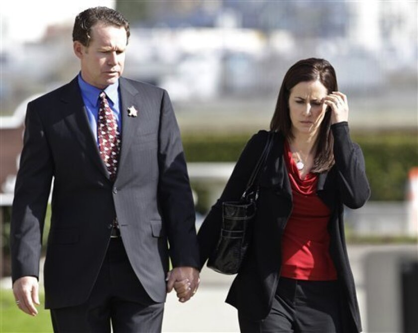 Alan and Caroline DeWeese, parents of Anthony DeWeese, walk to a Coast Guard court-martial in Alameda, Calif., Monday, March 7, 2011. Coast Guard Petty Officer Paul Ramos is charged in connection with a deadly boat crash after the Coast Guard vessel he was driving crashed into a boat in San Diego B