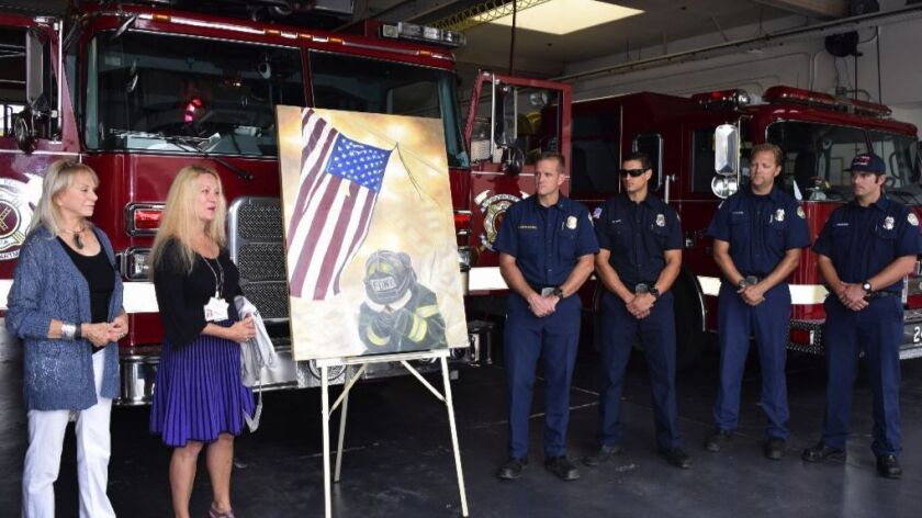 Wendy Moldow, Dr. Noemi Balinth and Solana Beach firefighters