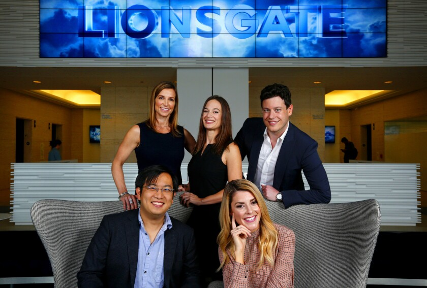 Lionsgate executives (top row) Jen Hollingsworth, Laura Kennedy, and Jordan Gilbert, photographed with YouTube stars Freddie Wong and Grace Helbig.