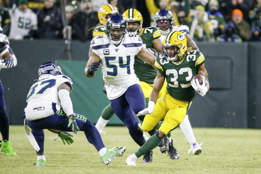 Green Bay Packers running back Aaron Jones carries the ball during a playoff game against the Seattle Seahawks.