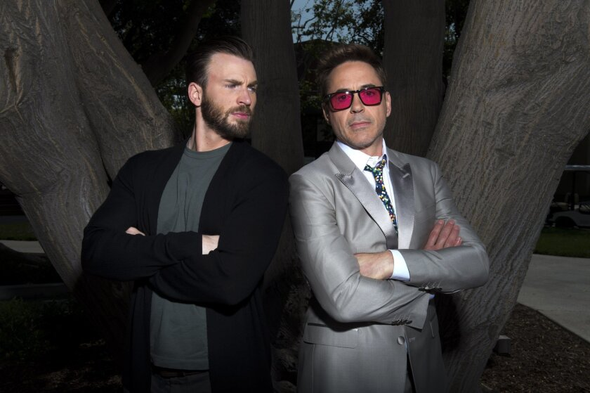 "In this April 11, 2015 photo, Chris Evans, left, and Robert Downey Jr. pose during a portrait session for ""Avengers: Age of Ultron"" at Walt Disney Studios in Burbank, Calif . (Photo by Jordan Strauss/Invision/AP)"