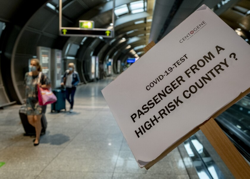 A sign helps passengers to find the Covid-19 test center at the airport in Frankfurt, Germany.