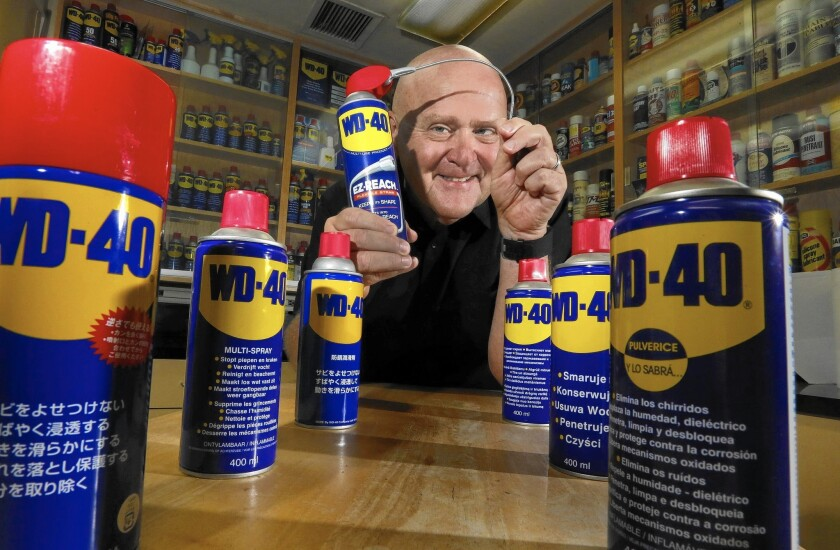 Garry Ridge, chief executive of WD-40, amid aerosol cans of his product at the company's San Diego headquarters.