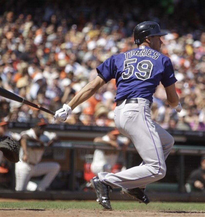 Colorado Rockies' Carlos Torres hits an RBI single off San Francisco Giants' George Kontos in the sixth inning of a baseball game Sunday, Aug. 12, 2012, in San Francisco. (AP Photo/Ben Margot)