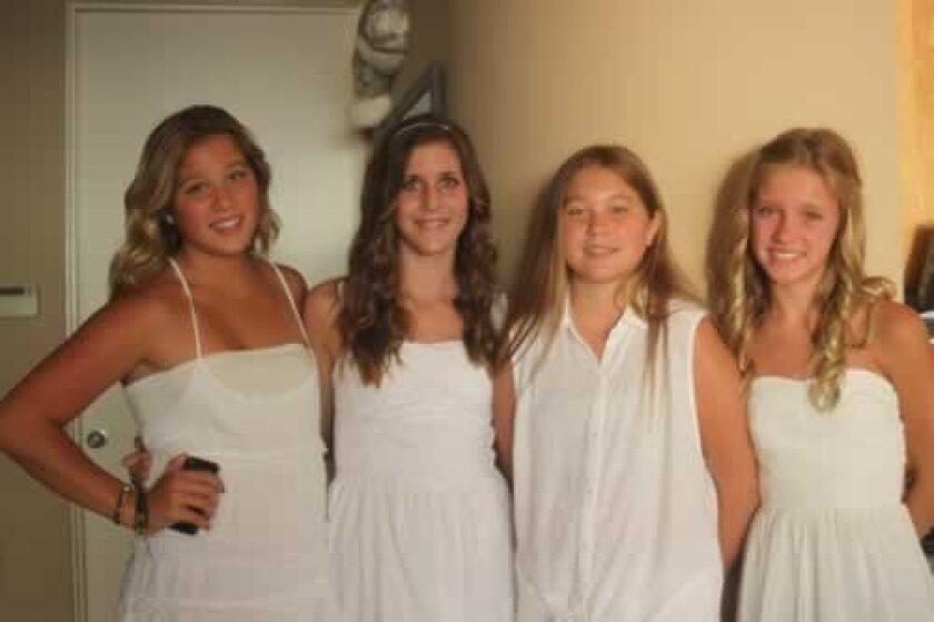 Hannah's twin sister Lauren Johnson, friend Sam Best, Hannah Johnson and friend Kylie Walker celebrate Hannah at a launch party for her crusade in La Jolla.
