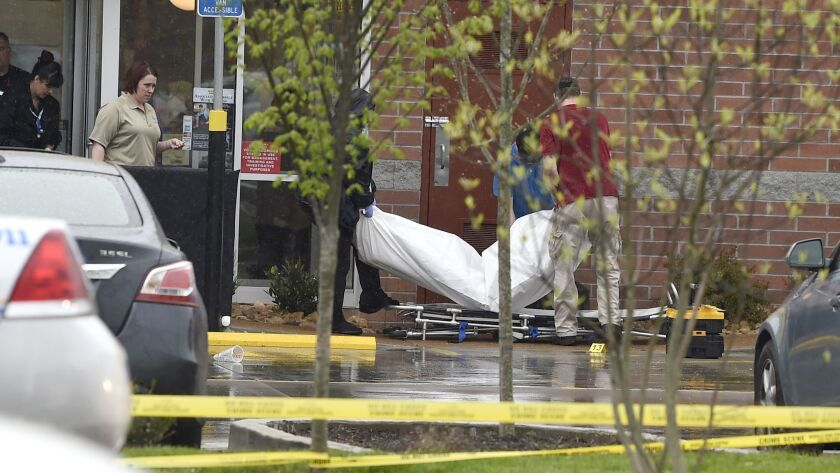A body is carried out of a Waffle House in Nashville, Tenn., Sunday, April 22, 2018. At least four p