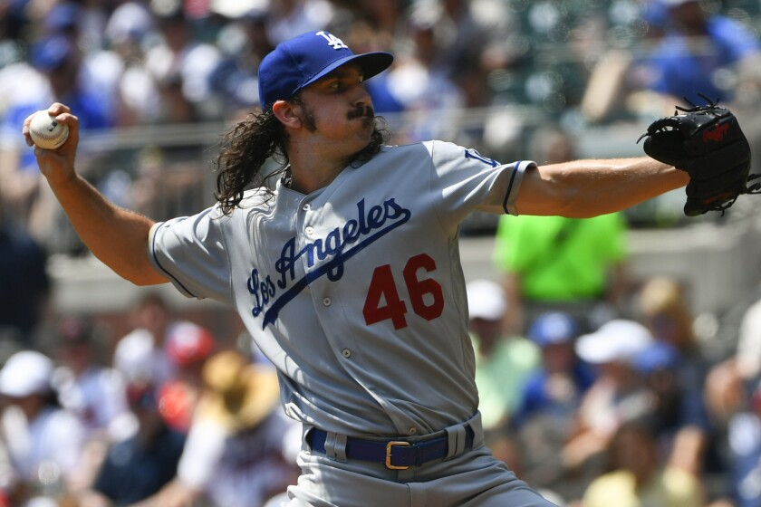 Dodgers pitcher Tony Gosolin delivers against the Atlanta Braves on Sunday.