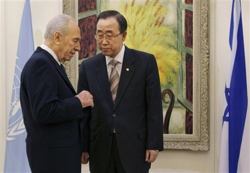 Israel's President Shimon Peres, left, meets with U.N. Secretary-General Ban Ki-moon, in Jerusalem, Thursday, Jan. 15, 2009. Israel shelled the United Nations headquarters in the Gaza Strip on Thursday, engulfing the compound and a warehouse in fire and destroying thousands of pounds of food and hu