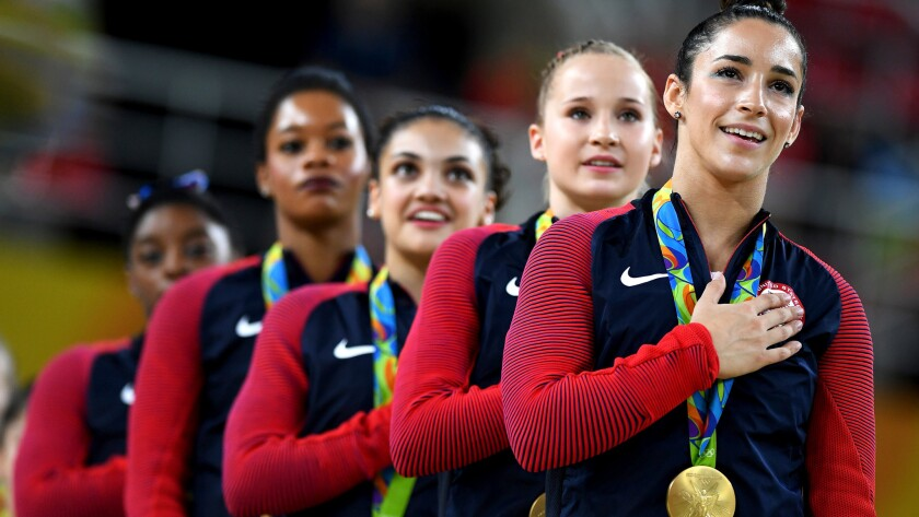 The gold medal-winning U.S. women's gymnastics team listens to the national anthem during the awards ceremony on Tuesday.