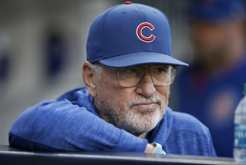 Chicago Cubs manager Joe Maddon looks on from the dugout before a game against the Padres in 2018.