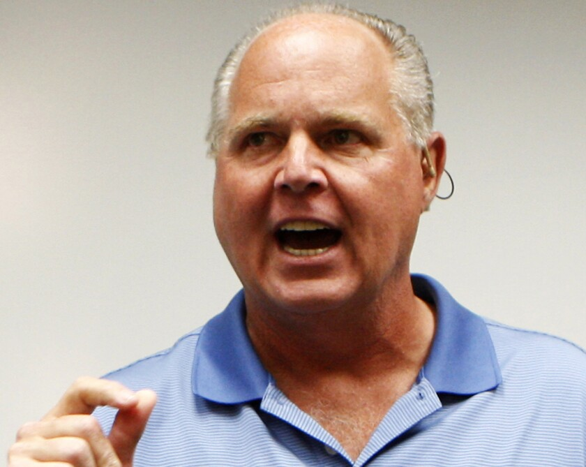 Rush Limbaugh speaks during a news conference in Honolulu.