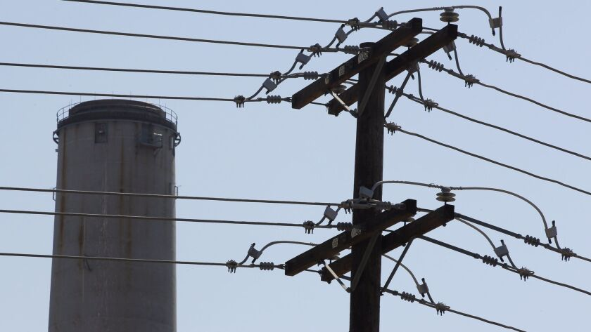 August 7, 2014, Carlsbad_| Power lines and the 400 foot smokestack tower of the Encina Power Station