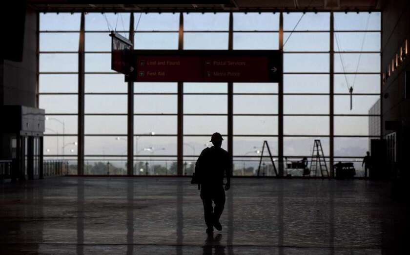A construction worker is silhouetted at Las Vegas' McCarran airport.