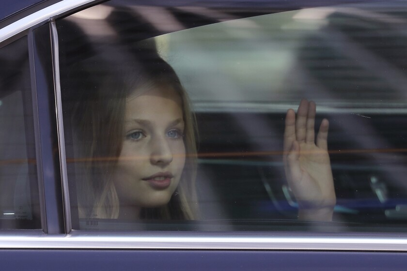 FILE - In this file photo dated Saturday, Oct. 12, 2019, Princess Leonor of Spain waves to the crowd after a military parade as they celebrate a holiday known as 'Dia de la Hispanidad' or Spain's Hispanic Day in Madrid, Spain. Heir to the Spanish throne, 15-year-old Princess Leonor will study a two-year course at UWC Atlantic College, in southern Wales, the Spanish royal household announced Wednesday Feb. 10, 2021.(AP Photo/Manu Fernandez, FILE)