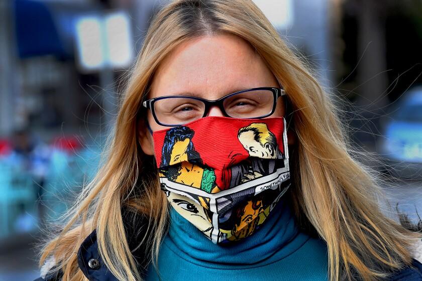 A woman in Croatia wears a pop-art face mask