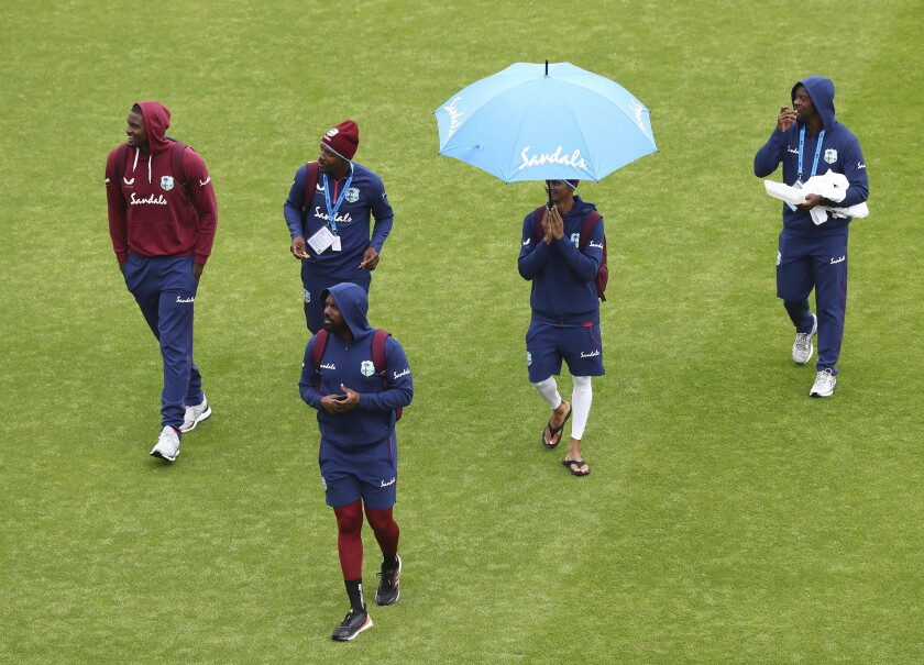 West Indies' captain Jason Holder, left, and teammates leave after the play is abandoned on the third day of the second cricket Test match between England and West Indies at Old Trafford in Manchester, England, Saturday, July 18, 2020. (Michael Steele/Pool via AP)