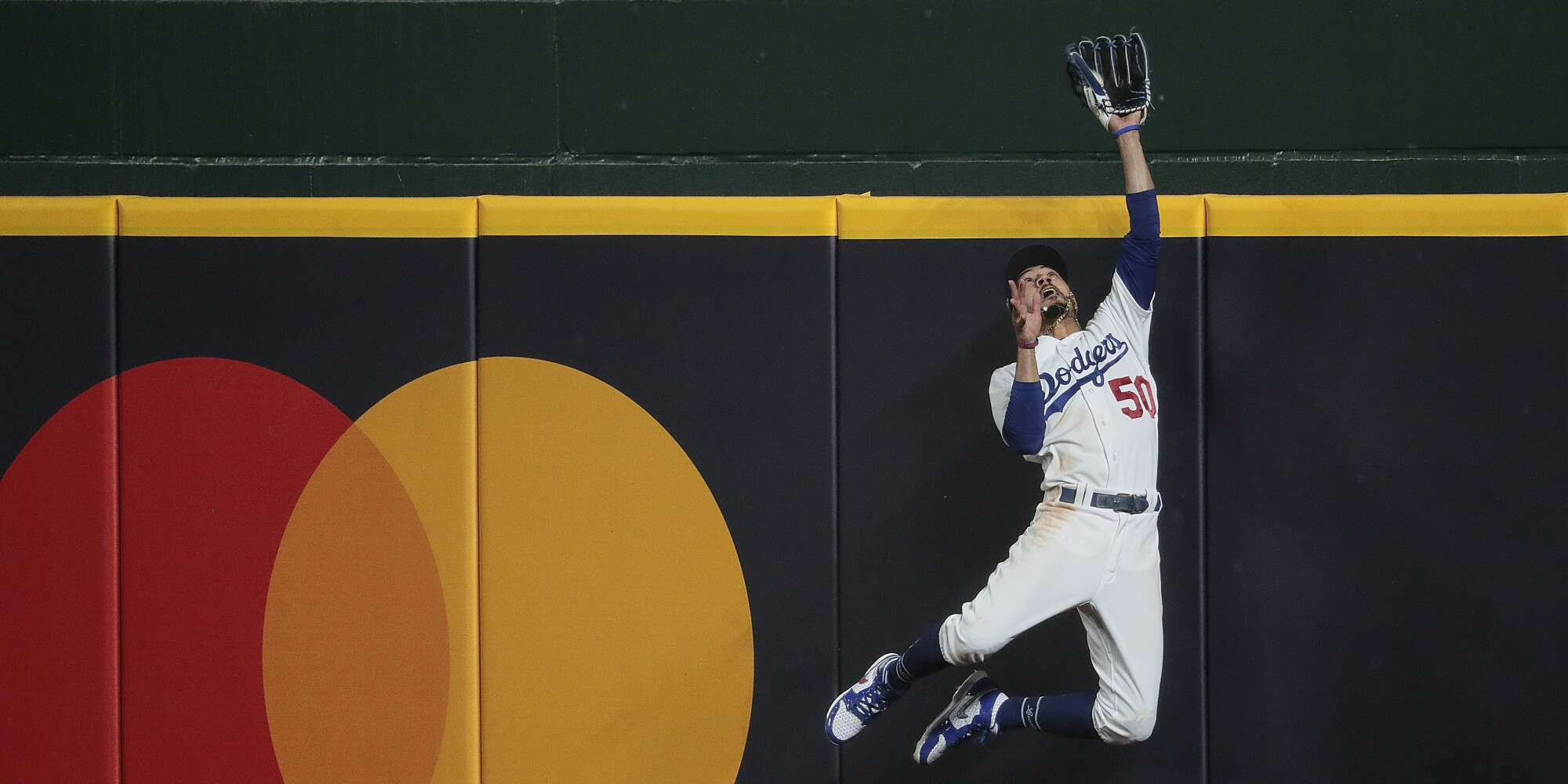 Dodgers right fielder Mookie Betts robs Atlanta Braves first baseman Freddie Freeman of a home run.