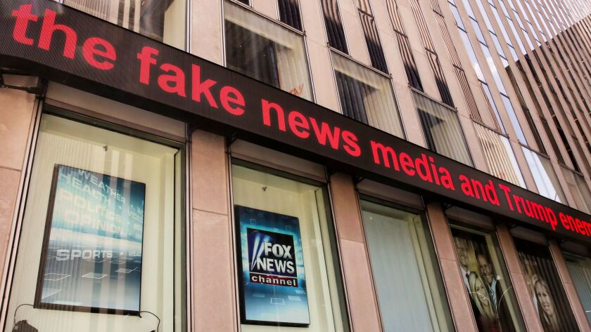 News headlines scroll above the Fox News studios in the News Corporation headquarters building in Ne