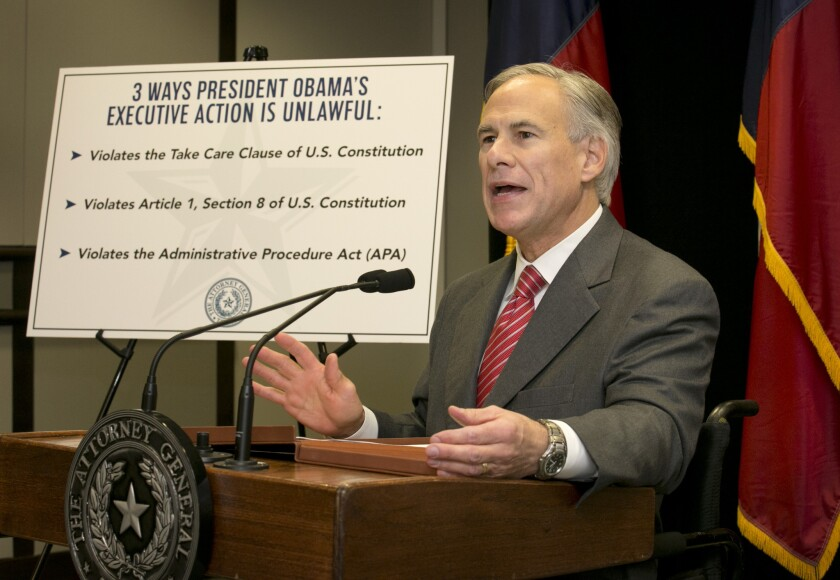 Texas Atty. Gen. and Gov.-elect Greg Abbott speaks against President Obama's executive action on immigration at the end of November. Abbott is leading a coalition of states which are challenging Obama's executive action.