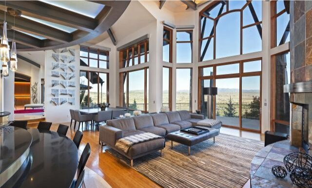 Built in 2006, the tri-level home holds five bedrooms, eight bathrooms, an expansive atrium, a movie theater, wet bar and golf course simulator.