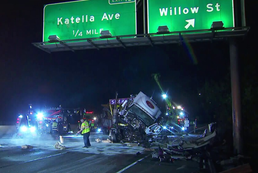 A big rig carrying a carnival ride called the Sizzler crashed into another vehicle, prompting a full closure of the southbound 605 Freeway