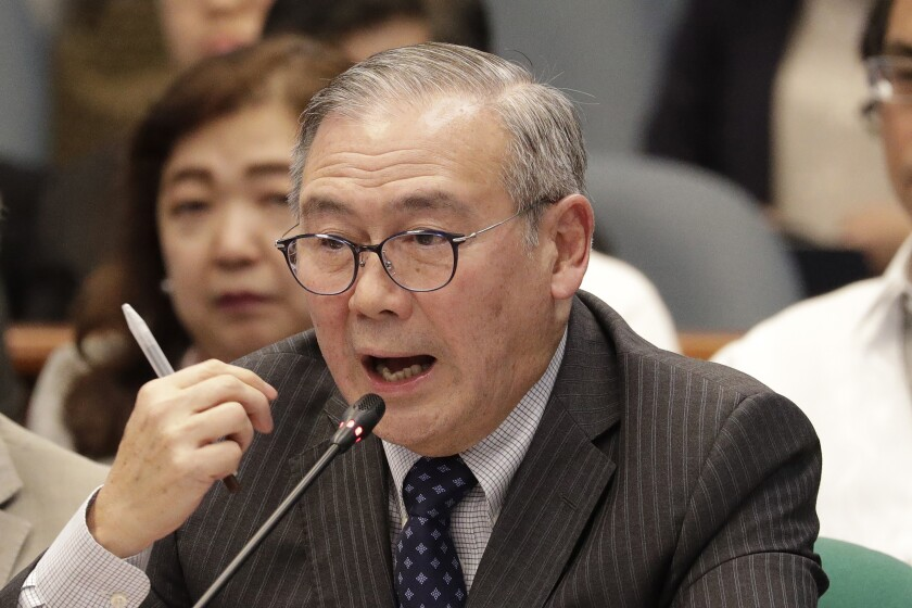FILE - In this Feb. 6, 2020, file photo, Philippine Secretary of Foreign Affairs Teodoro Locsin Jr. gestures during a senate hearing in Manila, Philippines. Locsin apologized Tuesday, May 4,2021, after tweeting an obscene phrase demanding China get out of Philippine-claimed territory in the South China Sea in an outburst that annoyed the Philippine president. (AP Photo/Aaron Favila, File)