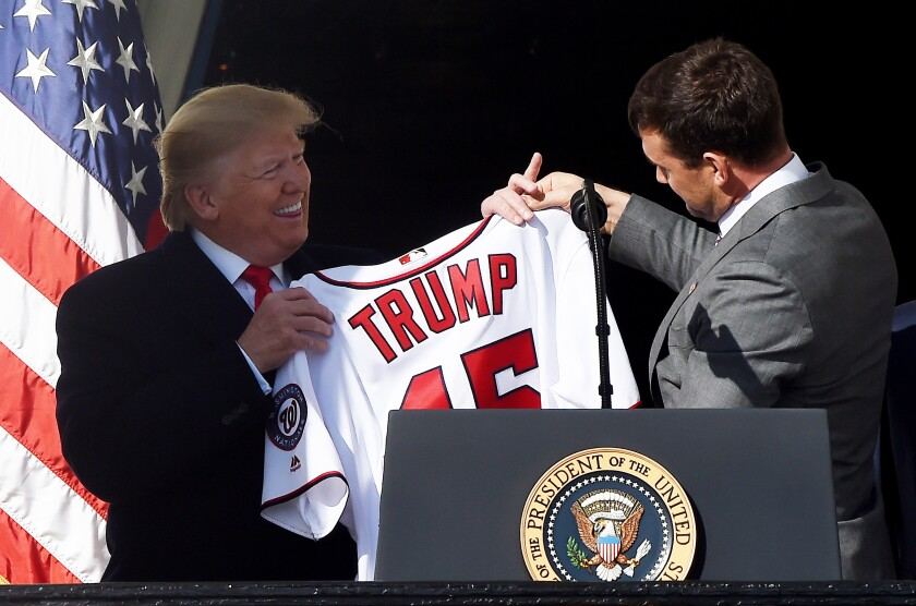 President Trump receives a jersey from Nationals first baseman Ryan Zimmerman