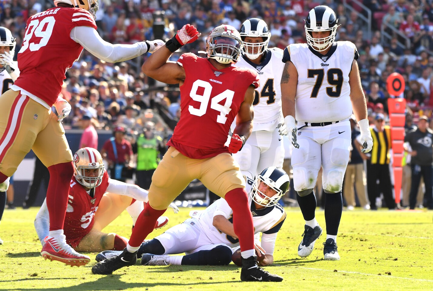 LOS ANGELES, CALIFORNIA OCTOBER 13, 2019-49ers defensive lineman Solomon Thomas (94) celebrates his sack of Rams Jared Goff in the 3rd quarter at the Coliseum Sunday. (Wally Skalij/Los Angeles Times)