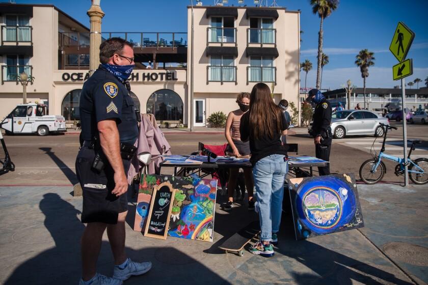 San Diego police officers patrol Ocean Beach on Aug. 12.