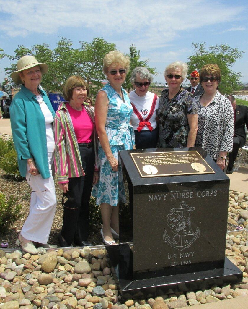 Members of the Navy Nurse Corps Association gather around their newly dedicated monument at Miramar National Cemetery. At far right is retired Navy Capt. Rebecca Nulty, Southern California Chapter president.