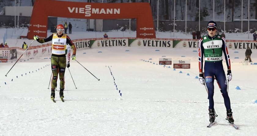 Winner Eric Frenzel of Germany, left, and disqualified Jarl Magnus Riiber of Norway, right, at the finish of the Cross-Country Individual Gundersen (10 km) of the Nordic Combined FIS World Cup competition at the Lahti Ski Games, the Pre-World Championships, in Lahti, Finland, on Friday Feb. 19, 2016. Riiber was disqualified from the first place because he used wrong ski track during skiing. (Jussi Nukari/Lehtikuva via AP) FINLAND OUT
