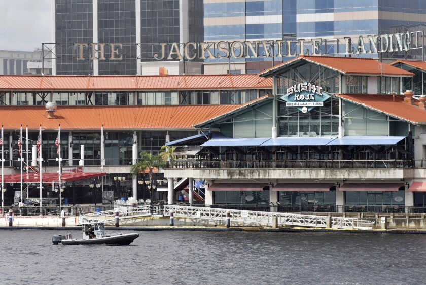 Law enforcement boats patrol the St. Johns River at the scene of a multiple shooting at the Jacksonville Landing Sunday, Aug. 26, 2018 in Jacksonville, Fla.