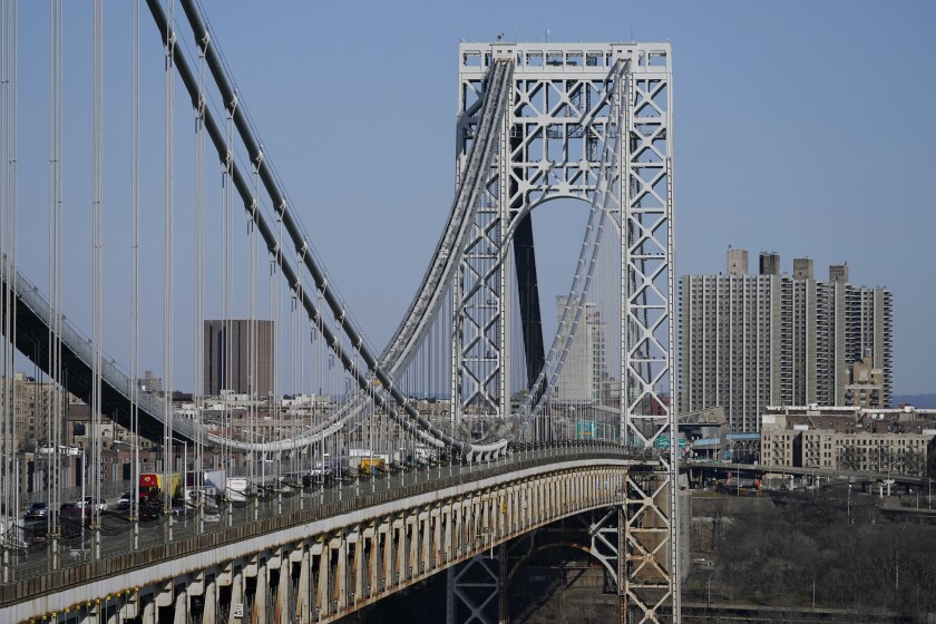 In this April 6, 2021, file photo traffic moves over the George Washington Bridge as seen from Fort Lee, N.J.