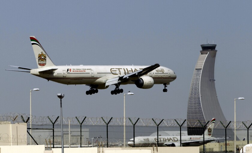 An Etihad Airways plane prepares to land at the Abu Dhabi airport in the United Arab Emirates. A group of U.S.-based airlines claim that Etihad Airways, Emirates Airline and Qatar Airways are competing unfairly in the U.S. by taking subsidies from their oil-rich governments.