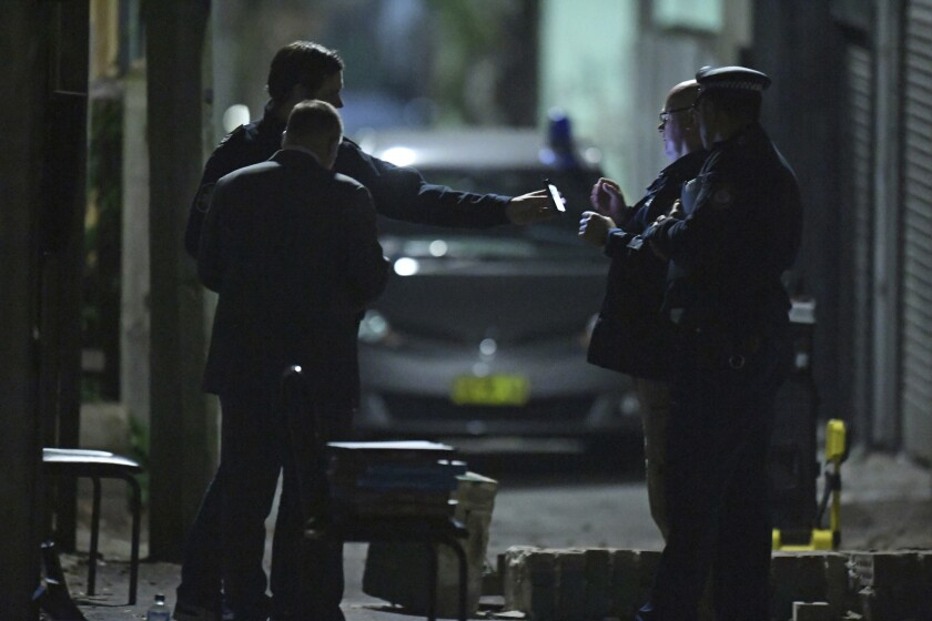 Australian Federal Police and NSW Police officers work in the Surry Hills suburb of Sydney, Australia on Saturday, July 29, 2017. Law enforcement officials raided properties in several Sydney suburbs and arrested four men on suspicion of plotting a terrorist attack related to a bomb plot involving aircraft, officials said.