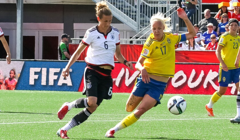 Germany's Simone Laudehr, left, battles for the ball against Sweden's Caroline Seger during the FIFA Women's World Cup round of 16 match on June 20. Germany won, 4-1, and will play France in the quarterfinals.