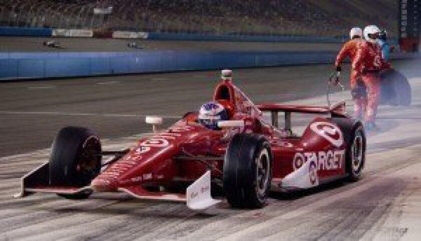 Scott Dixon leaves the pits