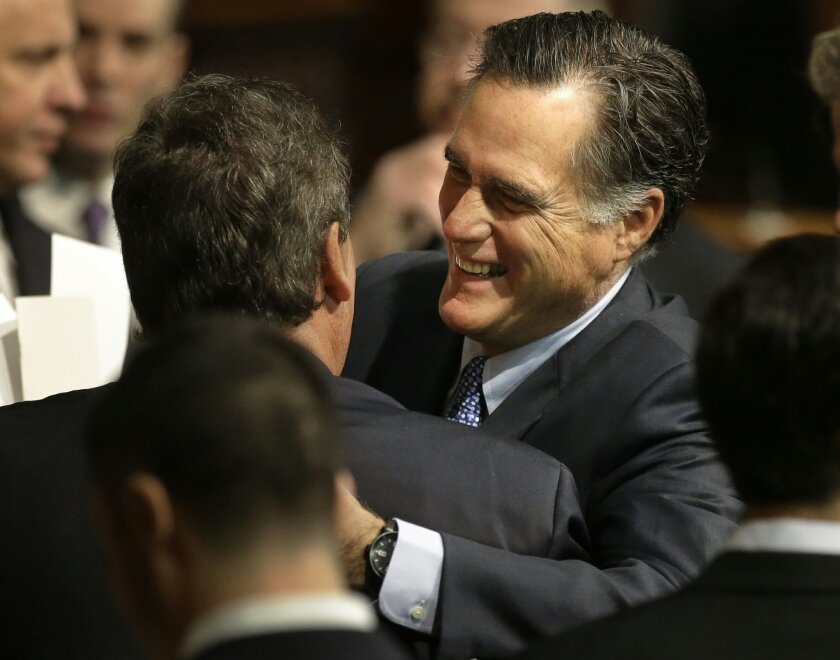 FILE - In this Jan. 8, 2015 file photo, former Massachusetts Gov. Mitt Romney, right, hugs N.J. Gov. Chris Christie on the floor of the House Chamber at the Statehouse in Boston before inaugural ceremonies for Charlie Baker. A shake-out among fiery conservatives with White House ambitions was alway
