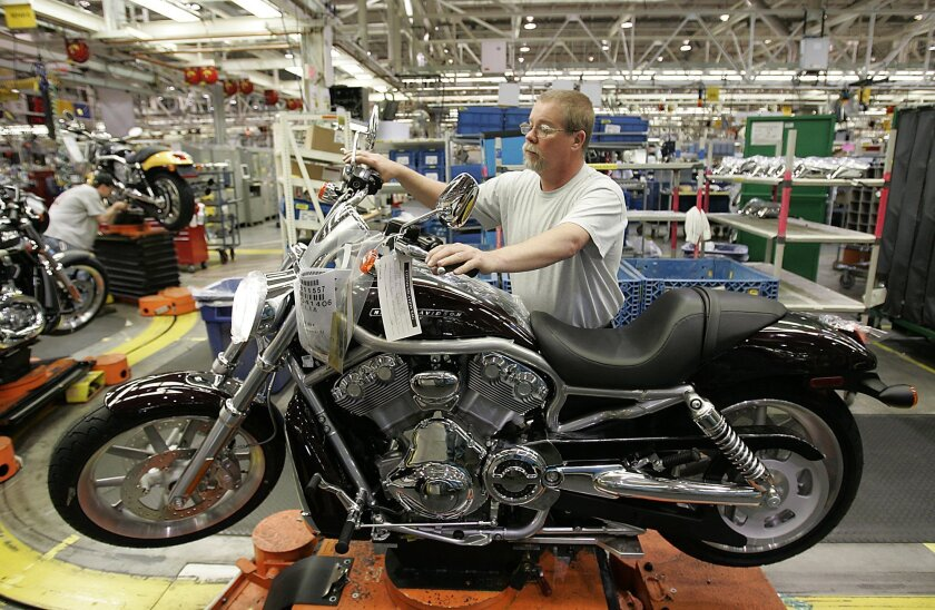 Jim Parker gives a final check to a V-Rod on the assembly line at the Harley-Davidson plant in Kansas City , Mo., in this 2006 file photo. Harley-Davidson announced on Jan. 30, 2018, it will close the Kansas City plant, at the cost of 800 jobs.