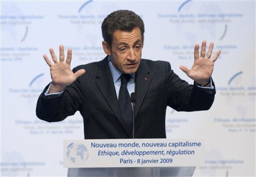 "French President Nicolas Sarkozy delivers a speech at the symposium ""New World, New Capitalism"" in Paris Thursday Jan. 8, 2009. Sarkozy and former British prime minister Tony Blair host a conference on the financial crisis focusing on values and development. Sarkozy has hit out at financial specula"
