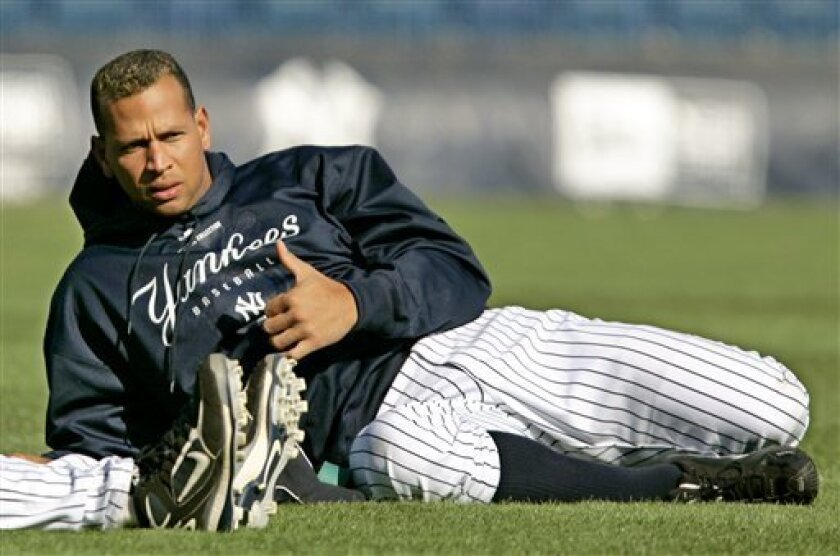 New York Yankees' Alex Rodriguez stretches out during a brief spring training baseball workout at Legends Field in Tampa, Fla., Tuesday, March 25, 2008. (AP Photo/Kathy Willens)