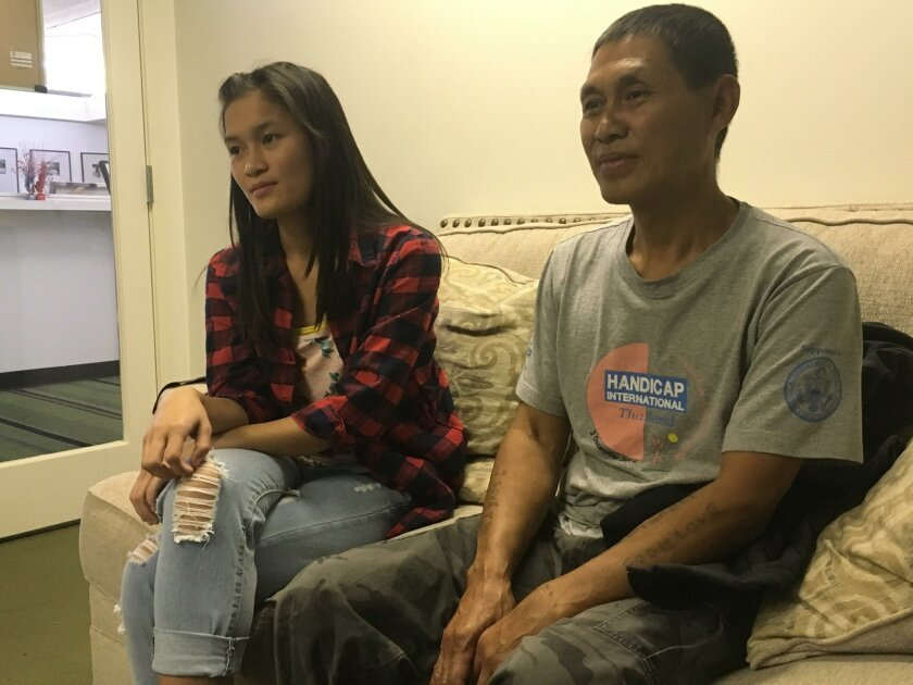 Yawlay Htoo, of Burma, and his daughter Kot Loe discuss a new report detailing refugee experiences.