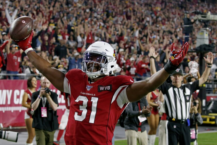 Arizona Cardinals running back David Johnson (31) celebrates his touchdown catch against the Pittsburgh Steelers during the second half of an NFL football game, Sunday, Dec. 8, 2019, in Glendale, Ariz. (AP Photo/Ross D. Franklin)