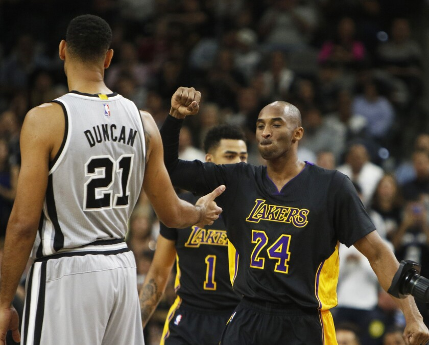 Los Angeles Lakers' Kobe Bryant (24) greets San Antonio Spurs' Tim Duncan before the game on Friday.
