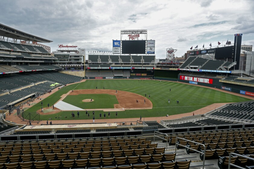 The Minnesota Twins run drills on Target Field at a baseball camp iMonday, July 6, 2020, in Minneapolis. (AP Photo/Bruce Kluckhohn)